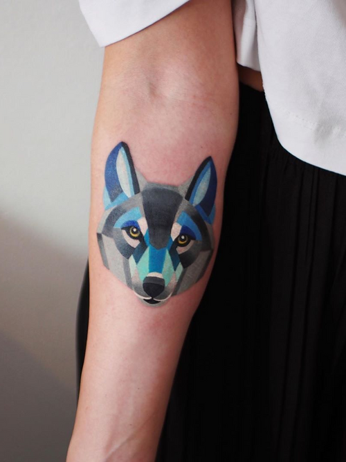 Wolf tattoo by Sasha Unisex #SashaUnisex #wolftattoo #wolftattoos #wolf #animal #nature #wolves #watercolor #watercolorwolftattoo #color #arm #graphicart