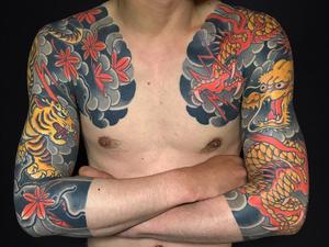 Japanese tattoo by Bunshin Horitoshi #BunshinHoritoshi #japanesetattoo #japanese #irezumi #color #dragon #tiger #smoke #mapleleaves #lightning #sleeves #arm
