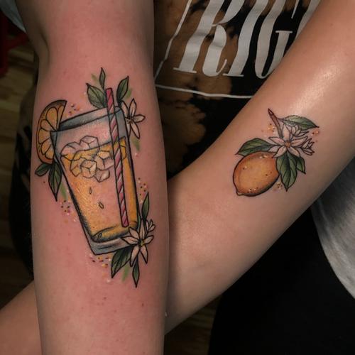 Matching best friend tattoos by Shelby L Golob #ShelbyLGolob #bestfriendtattoos #friendshiptattoos #friendtattoos #bfftattoo #matchingfriendtattoos #lemonade #lemons #colortattoo #foodtattoo #flowers