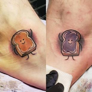 Matching best friend tattoos by Mitchell Von Trapp #MitchellVonTrapp #bestfriendtattoos #friendshiptattoos #friendtattoos #bfftattoo #matchingfriendtattoos #newschool #colortattoo #pbj #peanutbutter #jelly #foodtattoo