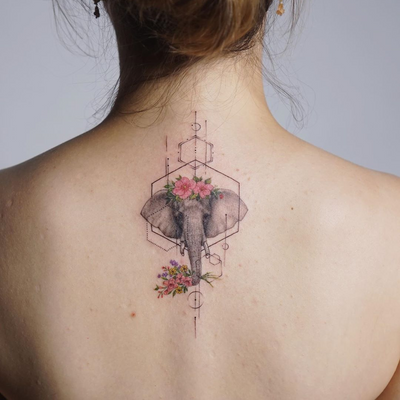 Elephant tattoo by Tattooist Silo #TattooistSilo #TattoodoApp #tattooartist #tattooart #tattooidea #inspiringtattoo #besttattoo #awesometattoo #floral #flower #sacredgeometry #elephant #animal #back