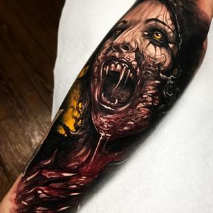 Horror tattoo by Brandon Herrera #BrandonHerrera #horrortattoos #horrortattoo #horror #darkart #evil #demon #darkness #death #vampire #color #blood #armtattoo
