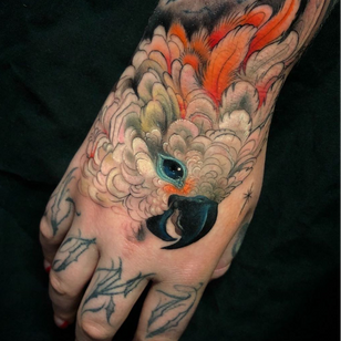 Hand tattoo by Aimee Cornwell #AimeeCornwell #LondonTattooConvention #LondonTattooConvention2019 #London #tattooconvention #color #painterly #bird #feathers #hand