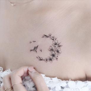 Cherry blossom tattoo by Tattooist Greem #TattooistGreem #cherryblossomtattoos #cherryblossom #flowers #floral #nature #plant #cherryblossomtattoo #illustrative #linework #fineline #hummingbird #chesttattoo #small