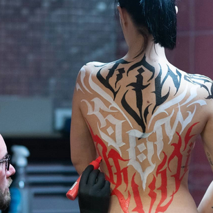 Live calligraphy painting by Mayonaize in collab with Benjamin Laukis #mayonaize #benjaminlaukis #LondonTattooConvention #LondonTattooConvention2019 #London #tattooconvention