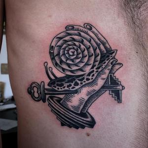 Snail tattoo by Franco Maldonado #FrancoMaldonado #snailtattoo #snailtattoos #snail #nature #animal #blackwork #key #hand #surreal #surrealism #darkart #linework