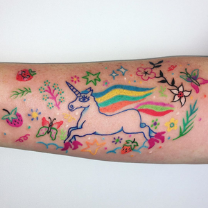 Unicorn tattoo by Charline Bataille #CharlineBataille #coverupsagainstabuse #coveruptattoos #coverup #tattoocommunity #tattooartist #unicorn #butterfly #flower #floral #stars #rainbow #arm #illustrative #color