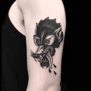 Wolf tattoo by Derick Montez #DerickMontez #wolftattoo #wolftattoos #wolf #animal #nature #wolves #traditional #traditionalwolftattoo #blackwork #blackworkwolftattoo #arm