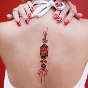 Norigae and peony tattoo by Tattooist Sion #TattooistSion #TattoodoApp #tattooartist #tattooart #tattooidea #inspiringtattoo #besttattoo #awesometattoo #norigae #ornamental #pattern #peony #flower #floral #back