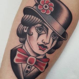 Lady head tattoo by Nikko Barber aka nikkotattooer #NikkoBarber #Nikkotattooer #Berlintattoo #tattooBerlin #traditional #AmericanTraditional #color #oldschool #lady #clown #ringleader #bowtie #ladyhead #portrait