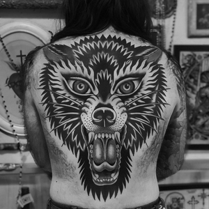 Wolf tattoo by Austin Maples #AustinMaples #wolftattoo #wolftattoos #wolf #animal #nature #wolves #traditional #backtattoo #backpiece #traditionalwolftattoo #back