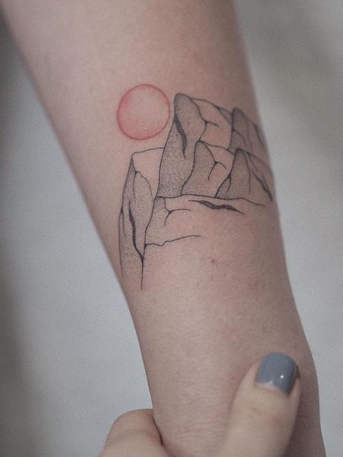 Mountain tattoo by sashathelittle #sashathelittle #coverupsagainstabuse #coveruptattoos #coverup #tattoocommunity #tattooartist #mountains #sun #illustrative #dotwork #linework #minimal #arm