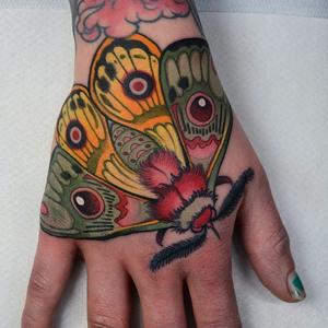 Hand tattoo by Jacob WIman #JacobWiman #tattooartist #tattoodo #tattoodoapp #awesometattoo #besttattoo #neotraditional #moth #butterfly #color #hand #handtattoo