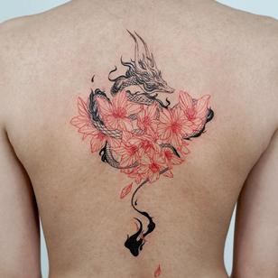 Cherry blossom tattoo by Bium Tattoo #BiumTattoo #cherryblossomtattoos #cherryblossom #flowers #floral #nature #plant #cherryblossomtattoo #illustrative #dragon #japanese #fire #petals #redink