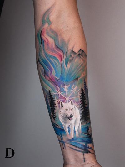 Wolf tattoo by Deborah Genchi #DeborahGenchi #wolftattoo #wolftattoos #wolf #animal #nature #wolves #auroraborealis #vikingcompass #watercolor #forest #arm #watercolorwolftattoo #realism #realistic
