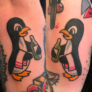 Best Friend Tattoos for Guys by Beau Adams #BeauAdams #bestfriendtattoos #friendshiptattoos #friendtattoos #bfftattoo #matchingfriendtattoos #penguins #traditional