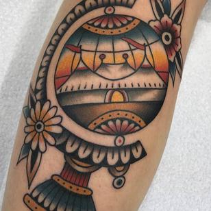 Globe tattoo by Nikko Barber aka nikkotattooer #NikkoBarber #Nikkotattooer #Berlintattoo #tattooBerlin #traditional #AmericanTraditional #color #oldschool #globe #circus #flowers #world