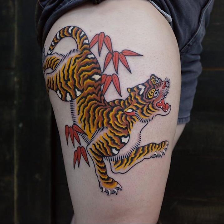 Tiger tattoo by Andrei Vintikov #AndreiVintikov #tattooartist #tattoodo #tattoodoapp #awesometattoo #besttattoo #tiger #tigertattoo #junglecat #mapleleaves #mapleleaf #cat #leg #color #japanese