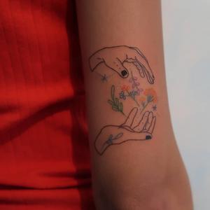 Illustrative tattoo by Katie Mcpayne #KatieMcpayne #illustrative #linework #queertattooer #vegantattoo #colortattoo #fineline #hands #flower #floral #arm #stars
