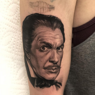 Horror tattoo by Jamie Mahood #JamieMahood #VincentPrice #horrortattoos #horrortattoo #horror #darkart #evil #demon #darkness #death #blackandgrey #movietattoo #actor #portrait #hollywood #armtattoo