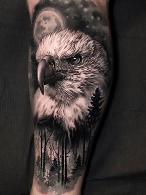 Eagle tattoo by Jose Contreras #josecontreras #tattooideas #tattooidea #tattooinspiration #tattoodesign #tattoodesignidea #tattooinspo #blackandgrey #realism #realistic #hyperrealism #eagle #feathers #forest #bird