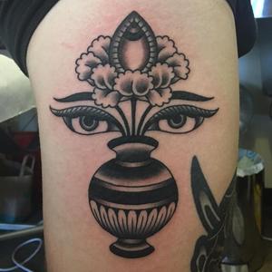 Buddhist tattoo by Joel Melrose #JoelMelrose #buddhisttattoo #buddhatattoo #buddhism #buddha #enlightenment #meditation #easternreligion #conch #shell #buddhaeye #vase #flower #traditional
