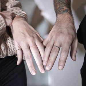 Ring finger tattoos couple tattoos by Ann Gilberg #AnnGilberg #coupletattoos #matchingcoupletattoo #relationshiptattoo #matchingtattoosforcouples #ringtattoos #fingertattoos #whiteink #whiteinktattoo
