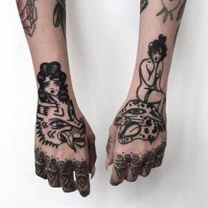 Blackwork tattoo by Monki Diamond #MonkiDiamond #blackwork #illustrative #handtattoos #hands #lady #wolf #cat #junglecat #leopard