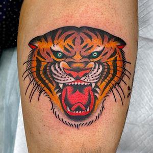 Traditional tattoo by Duan Woo - owner of Sick Rose Tattoo #DuanWoo #DuanTattoooer #SickRoseTattoo #China #chinatattooshop #chinatattoo #Shanghai #Shanghaitattoo #Shanghaitattooartist #traditionaltattoo #tigertattoo #tiger #junglecat #cattattoo