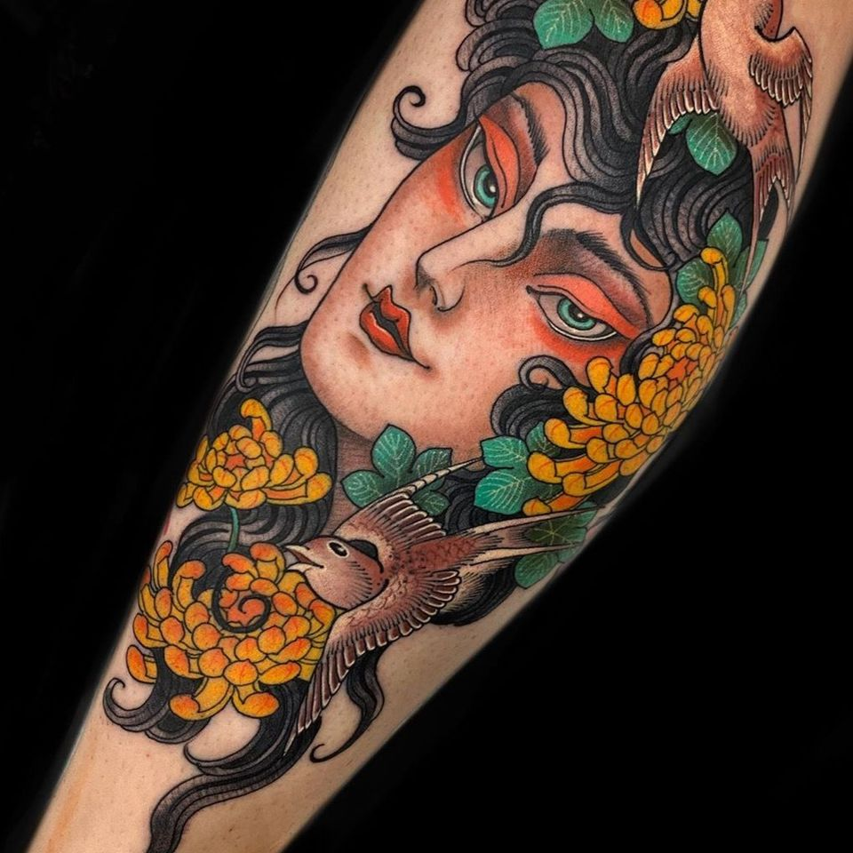 Lady head tattoo by Claudia De Sabe #ClaudiaDeSabe #neotraditional #japanese #ladyhead #portrait #color #chrysanthemum #birds #feathers #wings #flowers #floral #armtattoo
