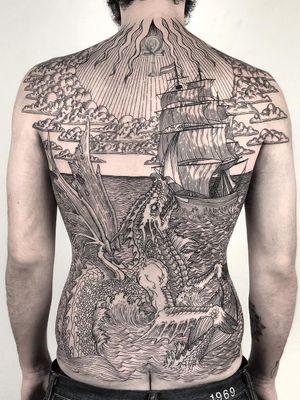 Dragon tattoo by Christopher Jade aka xcjxtattooer #christopherjade #xcjxtattooer #dragontattoos #dragontattoo #dragon #mythicalcreature #myth #legend #magic #fable #linework #blackwork #illustrative #medieval #backpiece #backtattoo