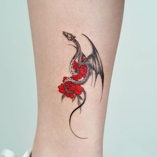 Dragon tattoo by Bium Tattoo #Biumtattoo #flowers #illustrative #fineline #dragontattoos #dragontattoo #dragon #mythicalcreature #myth #legend #magic #fable