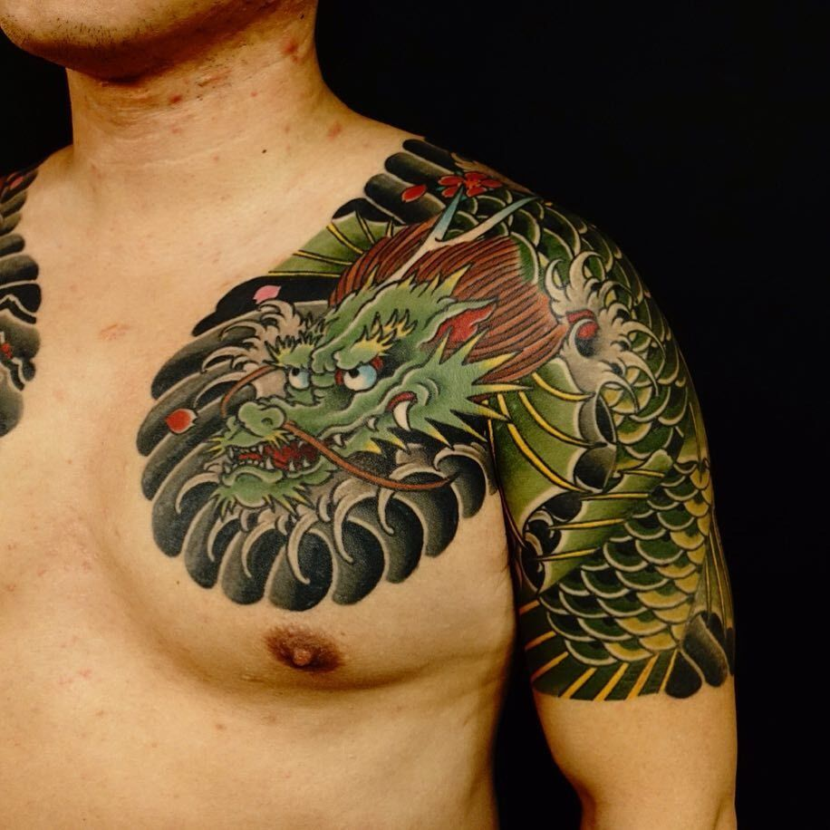Dragon tattoo by Damien Rodriguez #damienrodriguez #dragontattoos #Japanese #dragon #waves #cherryblossoms #scales #wings #mythicalcreature #legend #myth #mystical #folklore