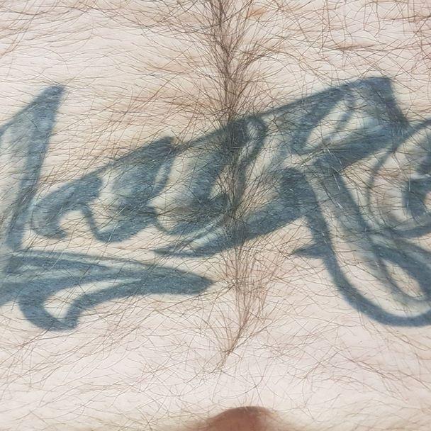 Artist unknown #tattooregret #stomachtattoo#regrettattoo
