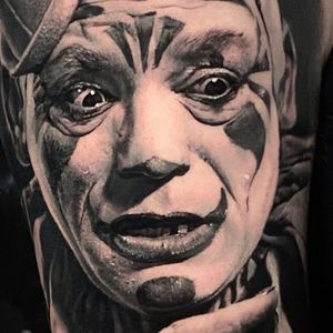 Clown tattoo by Thomas Carli Jarlier #ThomasCarliJarlier #blackandgrey #hyperrealism #realism #clown #joker #creepy #darkart #portrait