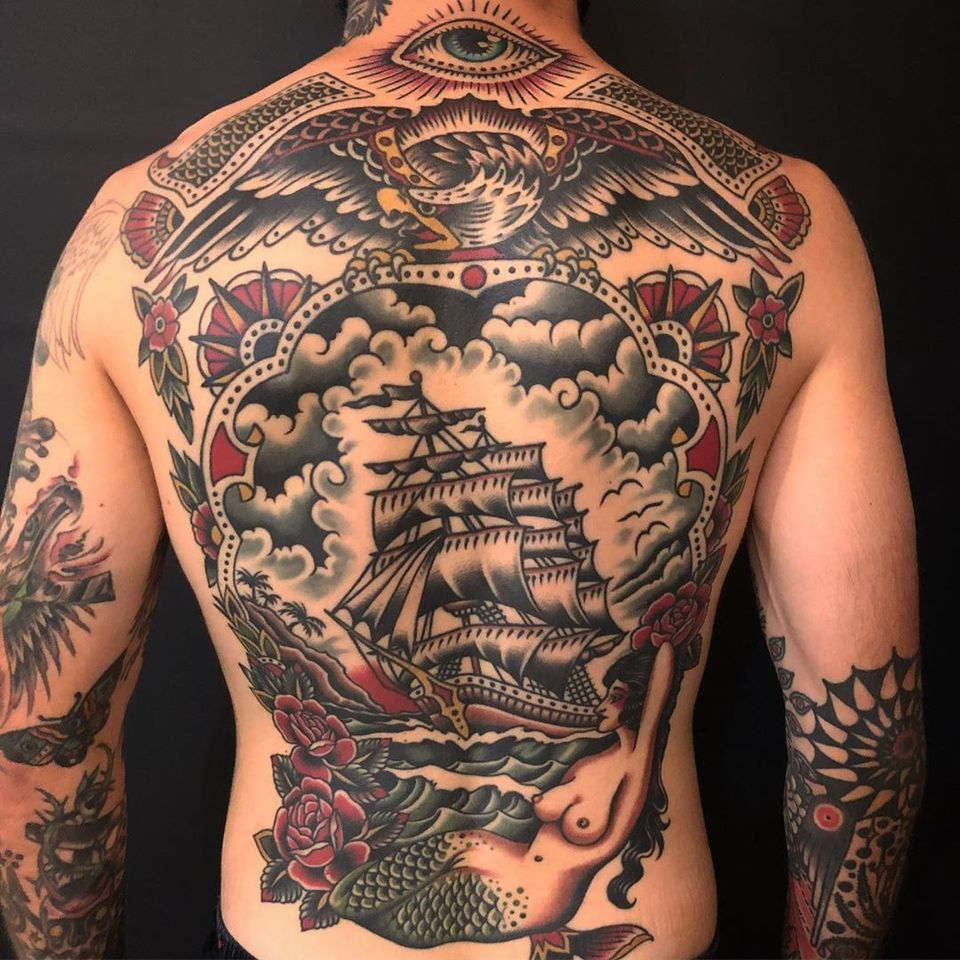 Back tattoo by Paul Dobleman #PaulDobleman #backtattoo #backpiece #tradiional #traditionaltattoo #eye #ship #ocean #eagle #mermaid #roses #anchor #clouds #compass #color