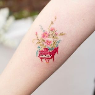 Illustrative watercolor tattoo by Ovenlee #Ovenlee #OvenleeTattoo #StudioBySol #watercolor #illustrative #colorpencil #sketch #cute #piano #music #flowers #floral #nature #plants