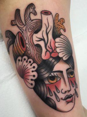 Surreal heart tattoo by Nikko Barber aka Nikko Tattooer #NikkoBarber #NikkoTattooer #traditional #illustrative #heart #anatomicalheart #portrait #ladyhead #tears #love