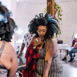 Tinuade tattooed by Oba Jackson - Photograph by Eric Rogers - The Experience of the Black Tattoo : Ink the Diaspora x Welcome Home #TheExperienceoftheBlackTattooer #InktheDiaspora #WelcomeHome #tattooflashevent #ObaJackson #EricRogers