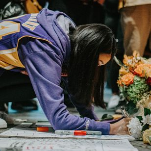 Fans at a Kobe Bryant memorial at Staples Center - Photograph by Fred Kearney