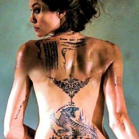 Fox and her tattoos in action in Wanted #badasstattoos #femaletattoos #filmtattoos #Fox #wanted #angelinajolie