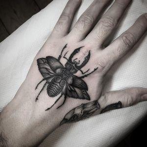 Beetle tattoo by Wulfbaron #Wulfbaron #darkart #japaneseinspired #illustrative #beetle #insect #hand
