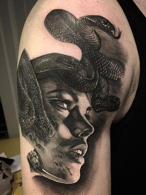 Snake and portrait tattoo by Lil Jeon #LilJeon #blackandgrey #realism #snake #portrait #lady #ladyhead #face #lips #animal #arm