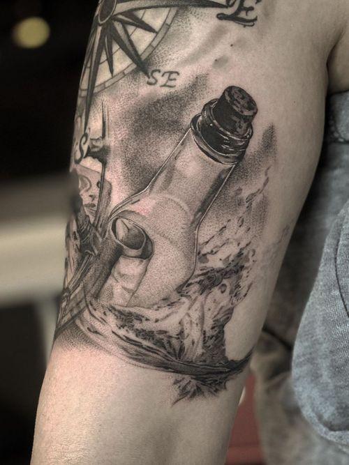 Message in bottle tattoo by Lil Jeon #LilJeon #blackandgrey #realism #bottle #glass #message #ocean #compass