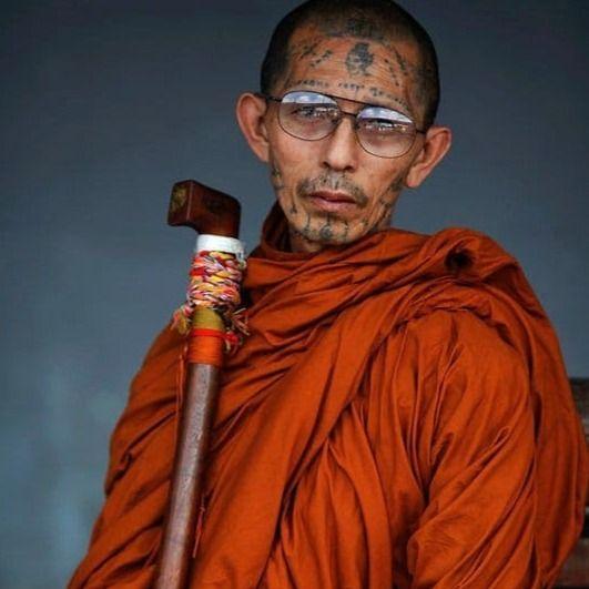 Portrait of a tattooed monk in Thailand by Damir Sagolj #DamirSagolj #Buddhisttattoos