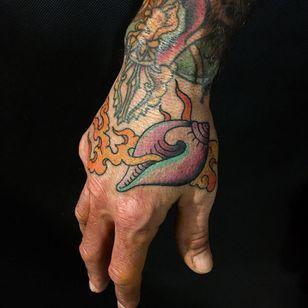 Conch shell tattoo by Garth B Neale #GarthBNeale #buddhisttattoo #buddhatattoo #buddhism #conchshell #shell #fire