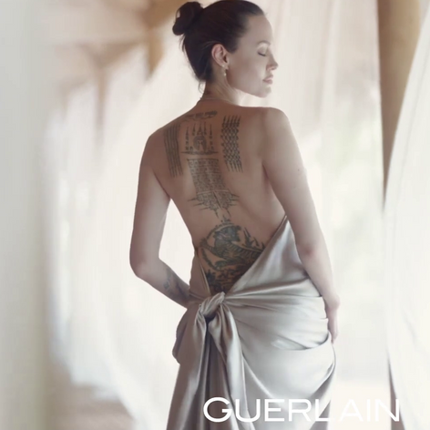 Angelina Jolie's real tattoo spotlit in a Guerlain campaign. #badasstattoos #femaletattoos #filmtattoos #Fox #wanted #angelinajolie