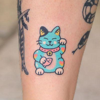 Hand poke tattoo by Han aka Hey Hey Diary #Han #HeyHeyDiary #handpoke #stickandpoke #nonelectric #kawaii #cute #tiny #small #funny #seoul #koreantattooist #luckycat #cat #fish #bell #color #blue