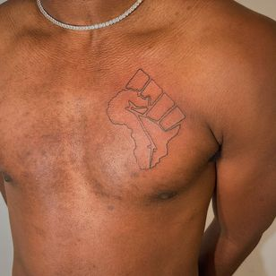 Black power fist in the shape of Africa tattoo by csndramay #csndramay #africa #africancontinent #blackpowerfist #blackpower #chestattoo #linework