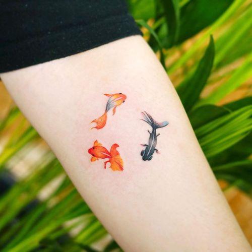 Watercolor tattoo by 9room #9room #watercolor #color #unique #nature #goldfish #fish #tinytattoo #smalltattoo
